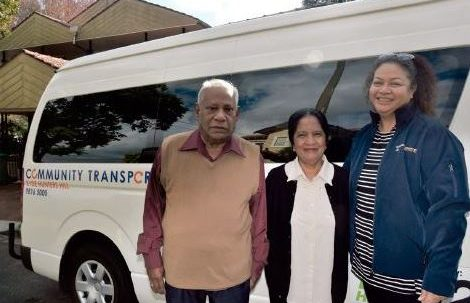 The Theagarajahs with their travel trainer and Easylink bus.