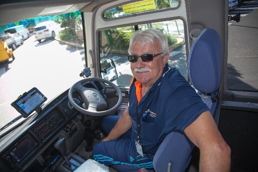 Volunteer driver Tony Juras in bus driver's seat